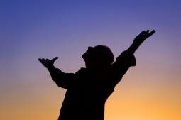 Man with arms raised in worship small